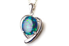 Elegant jewelry opal stone silver pendant heart Stock Photos