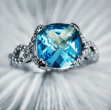 Elegant jewelry ring with brilliants and blue topaz Royalty Free Stock Images