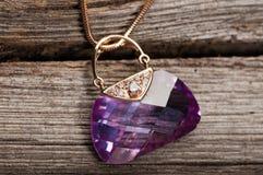 Elegant jewelry on wooden background Stock Photo