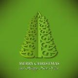Elegant julgran (snittpapper) på grön bakgrund Fotografering för Bildbyråer