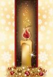 Elegant julkort med den guld- stearinljuset Arkivbild