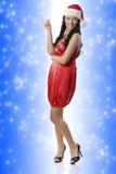 Elegant Kerstmismeisje in rood stock fotografie