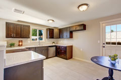Elegant kitchen with stained cabinets. Royalty Free Stock Photo