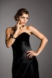 elegant kvinna för svart klänning royaltyfria foton