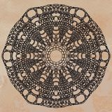 Elegant lacy doily Stock Images