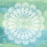 Elegant lacy doily on watercolor background. Stock Photography