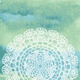 Elegant lacy doily on watercolor background. Royalty Free Stock Photography