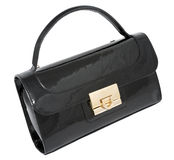 Elegant ladies handbag. Black ladies patent leather handbag, isolated on white, clipping path Royalty Free Stock Photos