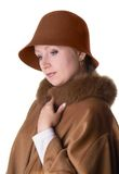 Elegant lady. In hat and coat in dreaming melancholical mood Royalty Free Stock Photo