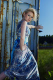 Elegant lady against old rusty container Royalty Free Stock Images