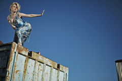 Elegant lady against old rusty container Royalty Free Stock Image