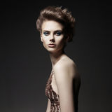 Elegant lady with art makeup and with fashionable haircut royalty free stock photography