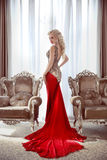 Elegant lady. Beautiful blond woman model in fashion dress with Stock Image