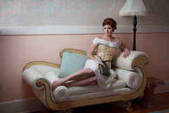 Elegant Lady on Couch Royalty Free Stock Photography
