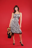 Elegant lady with cute little dog Stock Image
