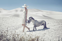 Elegant lady with the cute pony Royalty Free Stock Photo