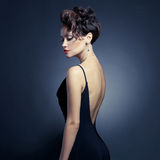 Elegant lady in evening dress royalty free stock photography