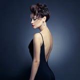 Elegant lady in evening dress. Fashion photo of beautiful lady in elegant evening dress royalty free stock photography