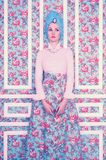 Elegant lady on floral background Stock Photography