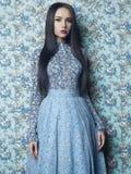 Elegant lady on floral background Stock Photos