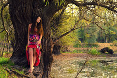 Elegant lady in the forest Royalty Free Stock Photos
