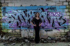 Elegant Lady with Graffiti Wall in Derelict Building royalty free stock photos