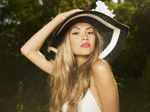 Elegant lady in a hat Stock Images