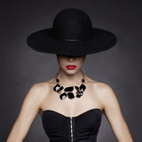 Elegant lady in hat Royalty Free Stock Image