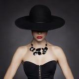 Elegant lady in hat. Fashion photo of beautiful lady in elegant black hat Royalty Free Stock Image