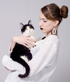 Elegant lady holding cat Stock Images