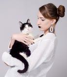 Elegant lady holding cat Stock Images