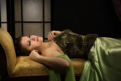 Elegant lady in a luxurious boudoir Stock Image