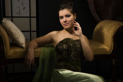 Elegant lady in a luxurious boudoir Stock Photos