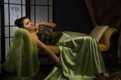 Elegant lady in a luxurious boudoir Stock Images