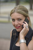 Elegant lady making phone call. Outside stock photo
