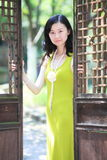 Elegant  lady opening the wooden door Royalty Free Stock Images