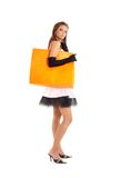 Elegant lady with orange shopping bag Royalty Free Stock Images
