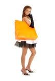 Elegant lady with orange shopping bag #2. Elegant lady with orange shopping bag over white Stock Photos