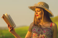 Elegant lady reading book Stock Images
