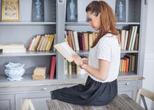 Elegant lady reading an interesting book Stock Images
