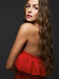 Elegant lady in red dress Stock Image