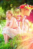 Elegant lady relaxing after bicycle ride Royalty Free Stock Photography