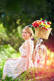 Elegant lady relaxing after bicycle ride Stock Image