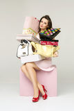 Elegant lady in a room full of fashion accessories Royalty Free Stock Image