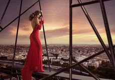 Elegant lady standing on the edge of the roof Royalty Free Stock Image