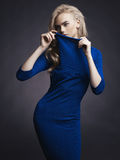 Elegant lady. Studio fashion photo of elegant beautiful lady in blue dress Royalty Free Stock Photography