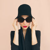 Elegant lady in a stylish hat Stock Photo