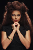 Elegant lady with stylish long hairstyle. Bright make up and bla Stock Image