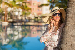 Elegant lady talking on phone while on vacation Royalty Free Stock Photos