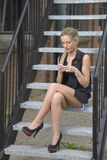 Elegant lady texting on phone. Elegant lady texting on mobile phone call outside stock images